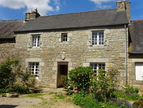 In the heart of the village , pretty stone house